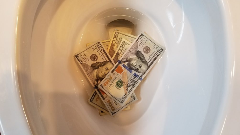 flushing money down